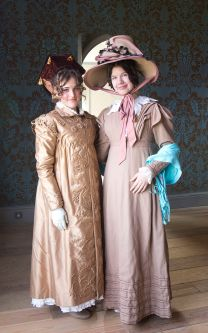 2 girls dressed in historical costumes
