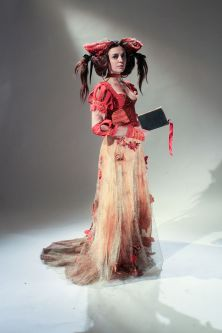 Red female costume worn by model.