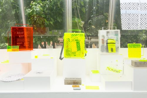 Display of work in the degree show. Neon and red cases.