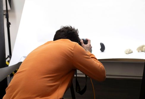 Photographer taking photo of objects