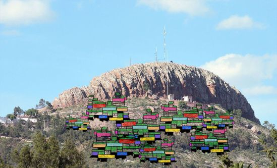 Illustration of coloured structures set against mountains