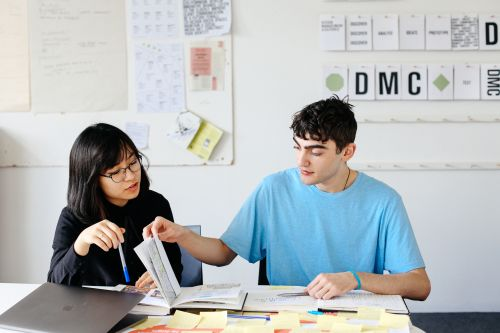 BA (Hons) Design Management student Ngoc (Sam) Trieu working in the studio at London College of Communication with Calvin England