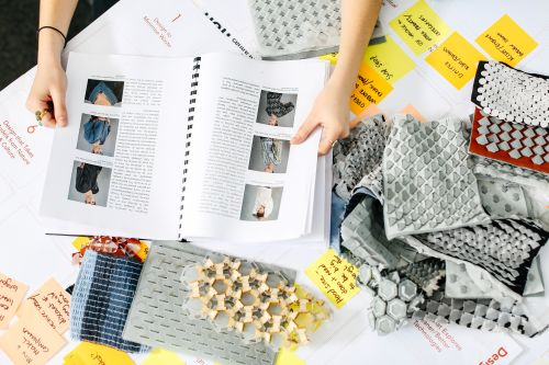 Laetita Forst's workspace with materials, samples and notebooks.