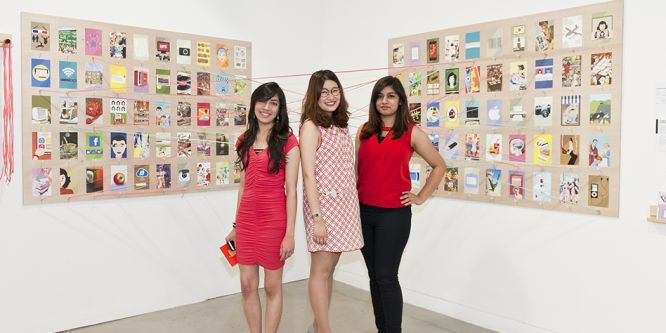 three ladies stand proudly in front of examples of ladybird covers