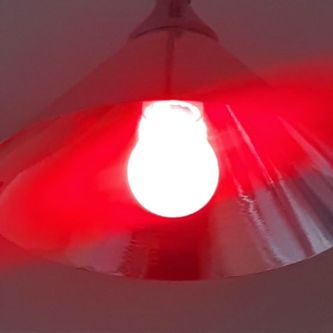 A close up of a red light bulb