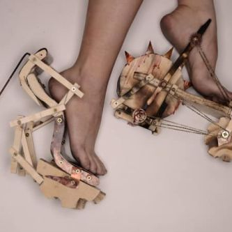 two heeled shoes made from wood