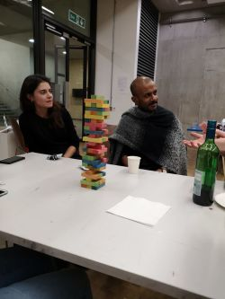 People sitting with coloured blocks on table