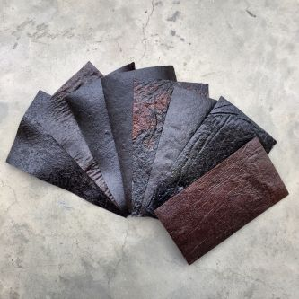 A selection of swatches of a material that resembles leather