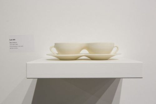 Photograph of ceramic teacups joined together on a plinth