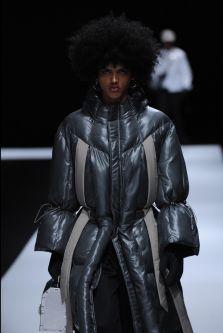 Male model wearing puffy jacket designed by Tzubin Cheng