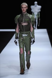 Blonde male model with green leather outfit