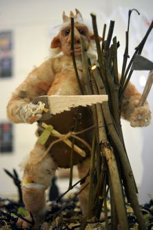 Creature sawing wood by Melanie Campbell.