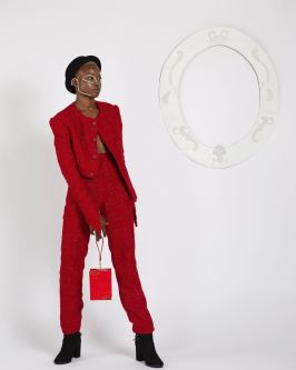 Female model wearing red suit