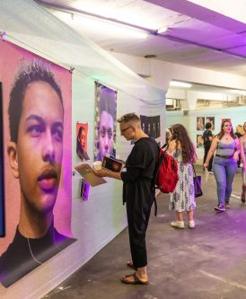 Guests look at the artwork