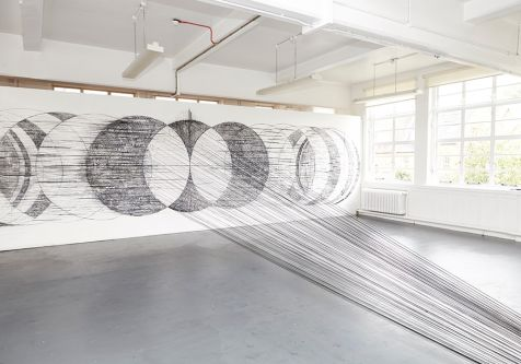 Large scale circular drawings made with black string by Jezella Pigott.