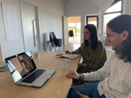 Image of two people looking at laptop