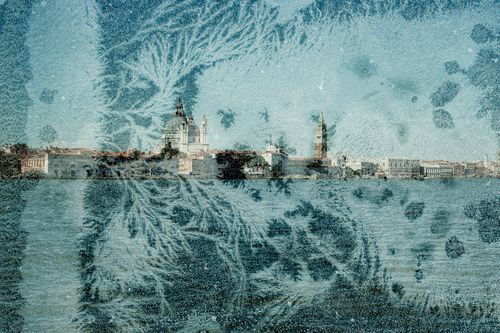 Image of Venice waterfront with a layer of frost on image.