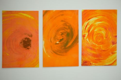 abstract painting of orange circles