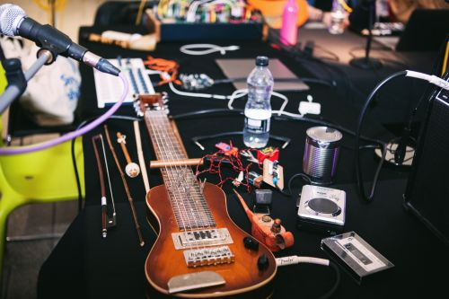 Close-up of an installation including various music-making equipment.