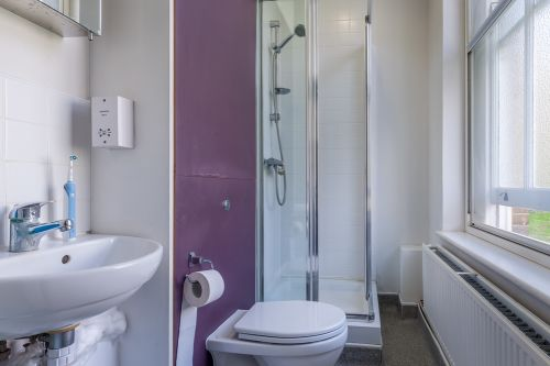 Standard premium room ensuite with sink, mirror, toilet and shower