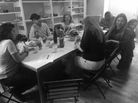 Group of people sat around a table