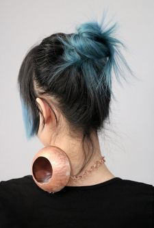 Copper vessel sitting on the back of a neck