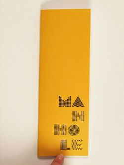 Tall yellow booklet cover featuring different patterned typography.