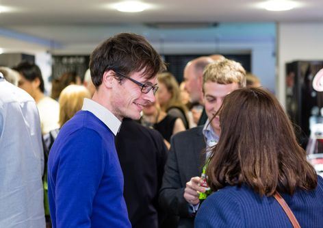 Postgraduate students having a conversation at an Industry Mentoring Scheme event at London College of Communication.