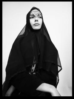 Model in black headscarf