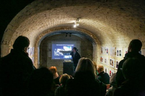Students attend a talk in the Crypt gallery