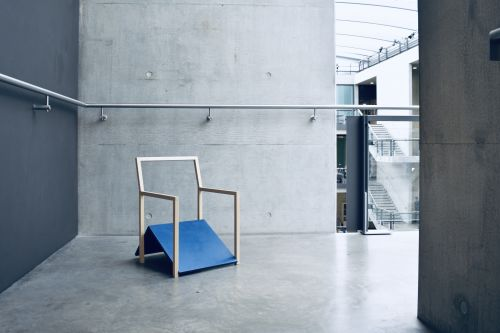 An abstract wooden chair on display