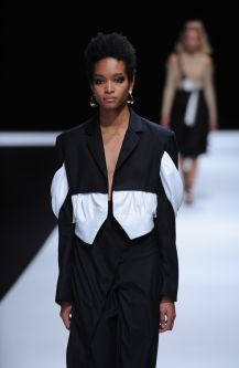 Female model wearing two piece black and white suit designed by Sijia Jiang