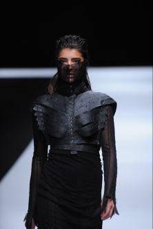 Female model wearing black jacket and face scarf designed by Eva Habanikova