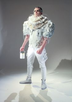 Intense all white costume with guns and aluminum can details by Rebecca Jempson.