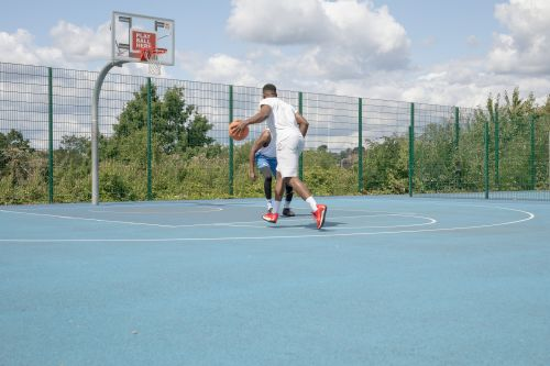 basketball player on blue court