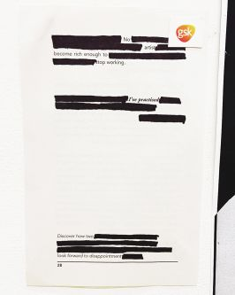 Document with blacked out text. Reads:
