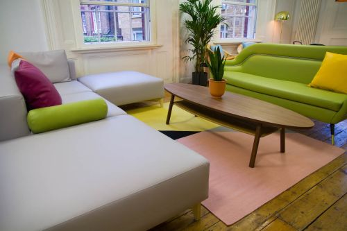 Common room with relaxed seating area and bold colours