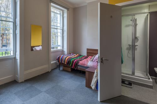Large premium ensuite room with shower, sink, toilet, large floor space, desk and large bright windows