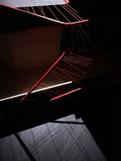 Model of structure made in card and red thread