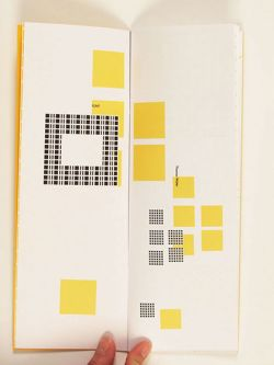 Open booklet featuring an arrangement of blocks of yellow and black and white patterns.