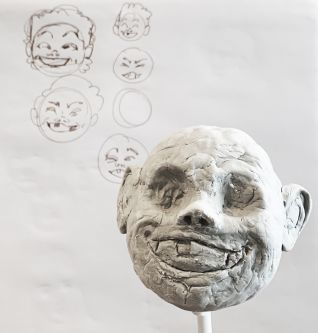 Modelled head in clay.