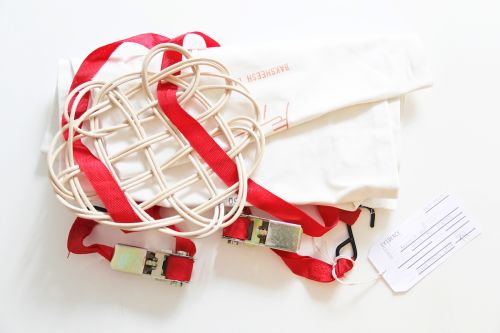 Red strap with white wires in a pattern on top
