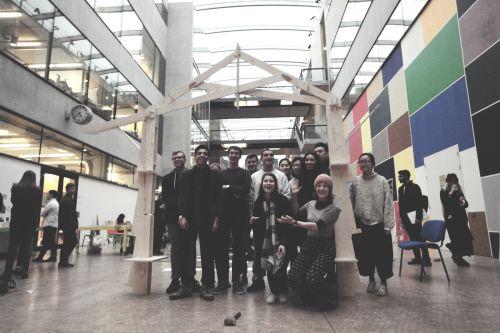 BA Architecture students raising their CNC cut structure