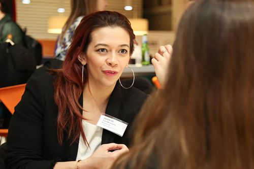 Photograph of two women in conversation at an Industry Mentoring Scheme event at London College of Communication. Photograph by Sundeep Verdi.