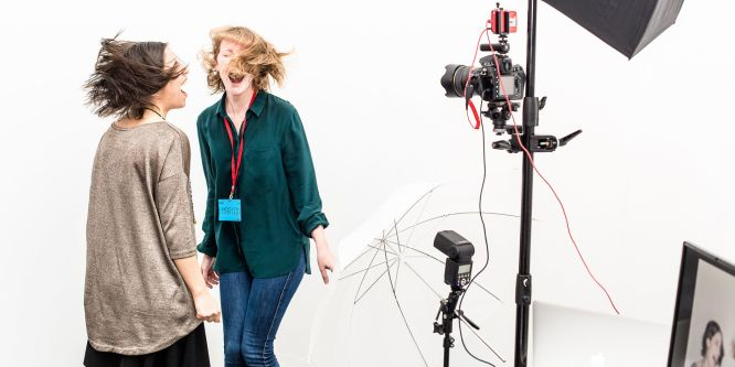 Two laughing girls in a photography studio