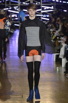 Model walking down catwalk