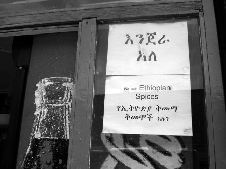 Shop front with sign in the window saying 'We sell Ethiopian spices'