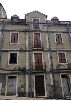 A tall dilapidated building