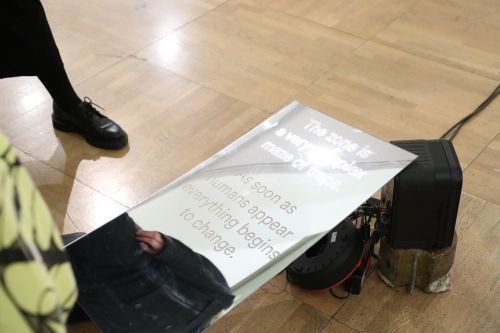 mirror lying on the floor with text on top