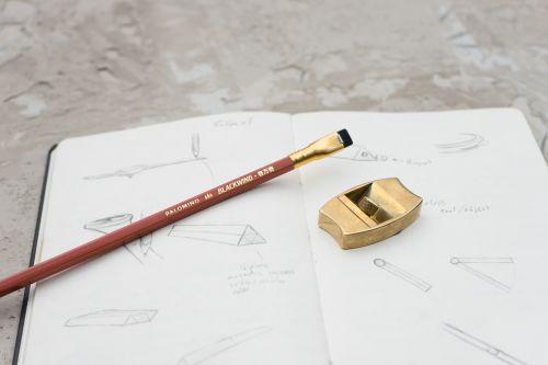 Pencil sharpener, pencil and paper